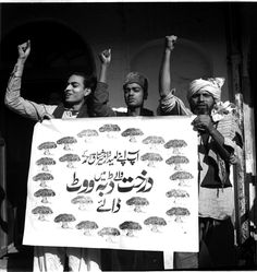 The supporters of the Socialist Party carrying a poster to appeal to voters to cast their vote in favour of their candidate.