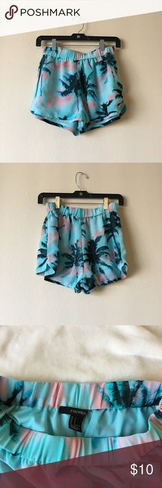 🏝Forever 21 Palm Tree Shorts SUPER CUTE! Forever 21 Palm Tree Shorts - Small (best fits a 24''-26'' waist) - Love the bright print perfect for summer wear them around the house as loungewear, casually out or over swimwear.  Elastic waistband - Not sheer ⭐️ Comment me if you have any questions and send me your bundle for a special discount 🥂 Forever 21 Shorts