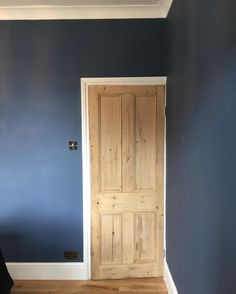 Farrow & Ball 'Stiffkey Blue' and stripped wooden Victorian doors