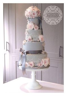 4 tier grey cake with cake lace, pearls & pale pink roses, crowned with an intricate rose pomander. 4 Tier Wedding Cake, Cool Wedding Cakes, Beautiful Wedding Cakes, Beautiful Cakes, Amazing Cakes, Pink And Grey Wedding Cake, Cupcakes, Cupcake Cakes, Love Cake