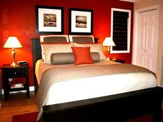 I love the color in this bedroom. The bold red accent wall pops against crisp white and black accessories, creating a room with va-va-voom. Small but sexy.