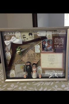 Wedding Shadow Box idea. Include photo booth pics, garter, cake topper, hanger, invite, favor tag, bell from ceremony, ect.