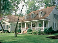 A deep, columned porch and gently sloping, dormered roofline give this Ericson Southern Plantation Home undeniable curb appeal. House plans here. | thisoldhouse.com