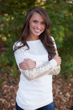 The Pink Lily Boutique - Arm Candy Sequin Sweater Ivory, $41.50 (http://thepinklilyboutique.com/arm-candy-sequin-sweater-ivory/)