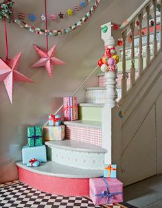 Celebrating the holidays at home in a colourful style; pretty pastel staircase.