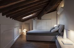 Skylight ushers in ample natural ventilation into the loft bedroom