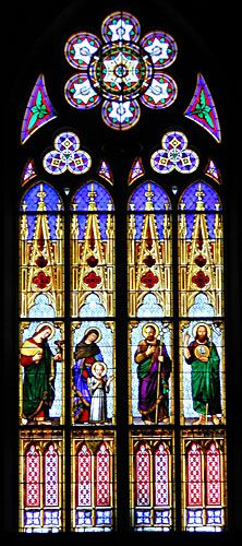 "The restoration of the ""Holy Family""window in the South Transept of St. Joseph's Church. The window had suffered from extensive vandalism and equally damaging restoration several times in the past. Of greatest concern was the condition of the paint fired on the glass. There were obvious areas of paint deterioration and the restoration included plating the interior and exterior of the glass to replace areas of missing paint."