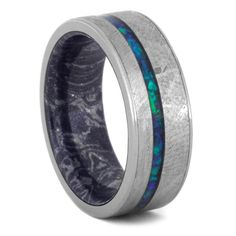 A unique a sophisticated crushed opal wedding band for men or women. Crushed opal lies in a bed of gibeon meteorite while sitting on the