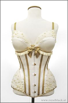 """""""Burlesque Angel"""" Underbust corset made from cream white silk with gold lamé bone casings, binding and details."""