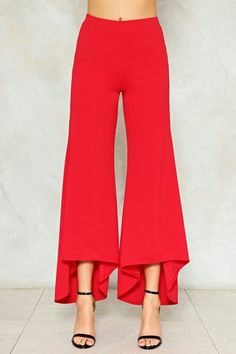 0aa03eeb9250 Take wide strides. These pants feature a flare, high-waisted silhouette,  elasticized waist, and ruffle detailing.