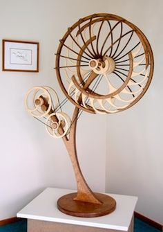 "This beautifully carved kinetic sculpture needs to be wound up to set it in motion. ""Jamboree"" Kinetic Sculpture by David C. Roy, Wood That Works"
