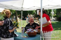 """Dan Heims greets Linnaeus volunteer Linda Helms during his book signing at the Linnaeus Teaching Garden June 4. Heims also gave a free lecture on the """"World's Greatest Perennials."""""""