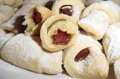 romanian food- cornulete fragede.   Whatever it is, it looks good.