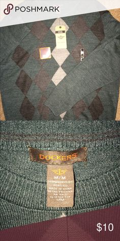 Dockers Sweater 🎈 Item is New With Tags and in great condition. Stored in a smoke free home. Feel free to bundle and negotiate prices 🌷 Dockers Sweaters Cardigan