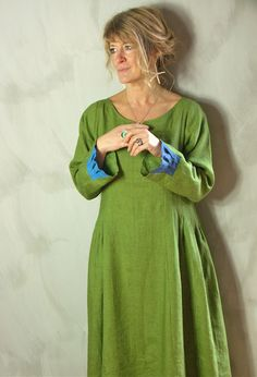 Love the pop of blue pleats at the wrist on this Terry Macey dress