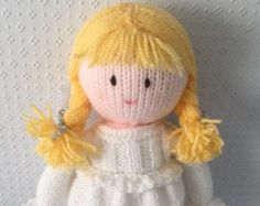 Welcome to DreamDollies, all our hand knitted dolls have their own special dream.  This is Christina, her Dream is to hear Santas sleigh bells.  She is hand knitted in acrylic wool and stuffed with 100% polyester hypo-allergenic toy stuffing. She is approximately 13 inches/ 33 centimetres tall and her clothes are not removable.  Thanks for looking.
