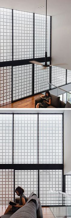 Materium have designed the Screen House, a home in Singapore, that features a large screen, allowing light in, while at the same time providing privacy.