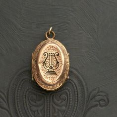Antique Locket Victorian Mourning  Tiny Lyre Taille by pinguim..... yes please- that's gorgeous