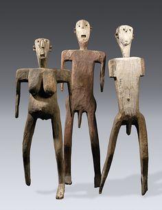 Figure maleGroup of Dance Figures, Sukuma Wood, pigment, metal, 132cm, 152.4cm, 142.2cm Private collection - QCC Art Gallery