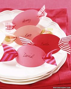 Peppermint-Candy Place Cards -   What could be sweeter? Cut out 3 ovals from colorful card stock. Using a hole punch, make a hole at each end, and then neatly write your guests names on the ovals with black ink. Thread ribbon scraps, each about 6 inches long and 1 1/2inches wide, through the backs of the place cards. Notch the ribbon ends, and set a card at each place setting.