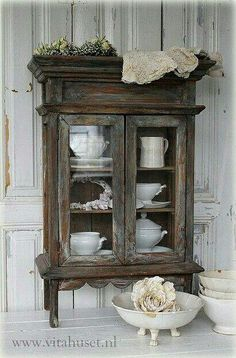 Glass cabinet - add legs and moldings/trim to top and bottom.
