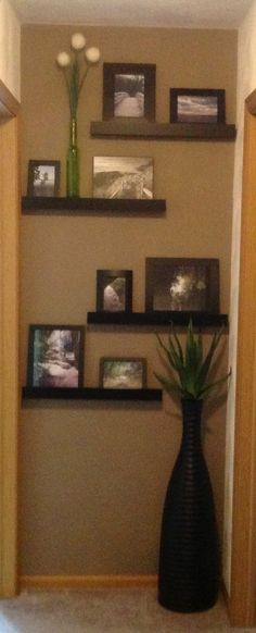 End of hallway photo display - randyinterior