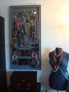 Jewelry pegboard.  She cleverly used canvas stretcher bars to make the frame.jpg