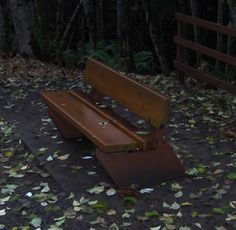 Bench with no armrests and ledge in clear space in front of it