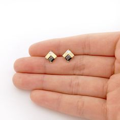 These beautiful square shaped stud earrings are sparkled with princess cut simulated diamonds and natural onyx gemstones. The studs are crafted in real gold… Diamond Earrings Indian, Gold Jhumka Earrings, Gold Earrings Designs, Pearl Stud Earrings, Necklace Designs, Gold Necklace, Gold Earrings For Kids, Kids Earrings, Small Earrings