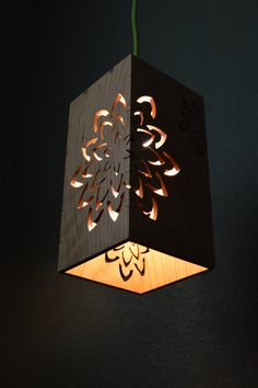 This wooden hanging lamp is perfect for any space and any age. The design has two large flower cut outs and the smaller flowers are etched into the wood. The lamp is made out of solid Cherry wood and is finished with a satin Polyurethane. The lamp measures 4.75 x 4.75 x 9. The lamp is available with a 12 fabric cord. The cord has a toggle switch and is a 3 prong cord which allows you to plug in the light or hard wire, if desired. The cord is available in black, white, black and white braid…