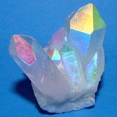 Angel Aura quartz crystal cluster Angel Aura Quartz is an uplifting spiritual stone that invites angel guidance, deep peace during meditation and purification.