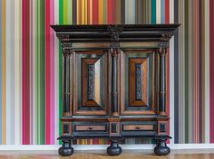 Rijksmuseum DNA by Irma Boom. Hang one of 18 famous paintings from the Rijksmuseum on your wall with Colour DNA wallpaper. Renowned graphic designer Irma Boom spent ten years deconstructing the museum's paintings to distill their colour DNA – the six colours that make up the painting. These DNA swatches of an individual painting, like Vermeer's The Milkmaid, are available as wallpaper in narrow or broad striping. Just choose and /or combine your favorite classic for your wall.