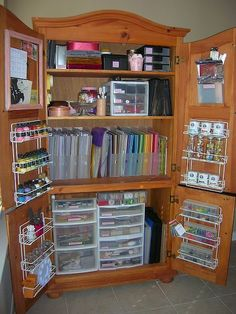Armoire repurposed as crafting storage.. this would be great for my art supplies!