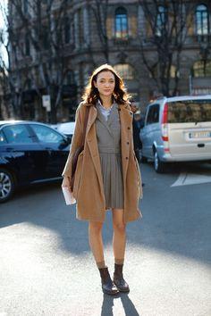 school dress and a beige coat