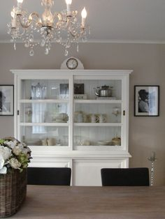 I am obsessed with hutches! And this whole room is beautiful! Love the tall candle holders and chandelier!