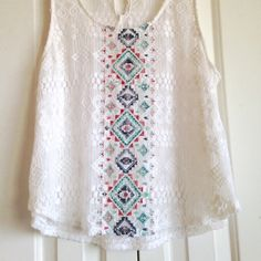Tobi Sheer Crochet Tank Top Beautiful crochet detail on this white tank top by Tobi. This top is perfect for those hot summer days and can be worn over a sports bra, bralette, or your favorite camisole. This top has been worn only once and is in great condition. Tobi Tops Tank Tops