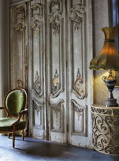 Detailing on the doors. Green French chair. Brilliant toned lampshade.
