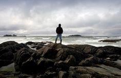 Person at Chesterman Beach, Tofino, British Columbia (© Design Pics Inc./Alamy) ()