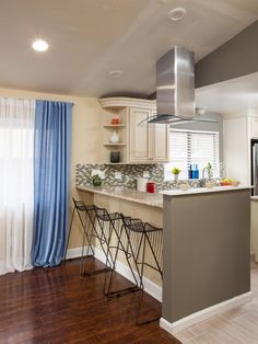 Before, a partial wall isolated the island from the rest of the kitchen. Now, the homeowners can easily interact while they enjoy a bowl of cereal or the morning news at the updated breakfast bar, as seen on HGTV's Brother Vs. Brother.
