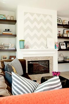nice chevron print over fireplace and adjacent shelves!