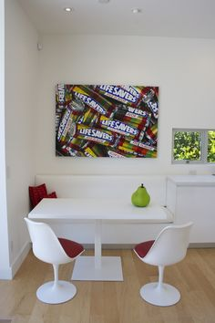 Loving this modern kitchen with retro seating and Lifesavers art. The kitchen table (with oversized pear) ties it all together