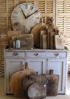 Prim Needfuls...old bread boards, cupboard and clock.