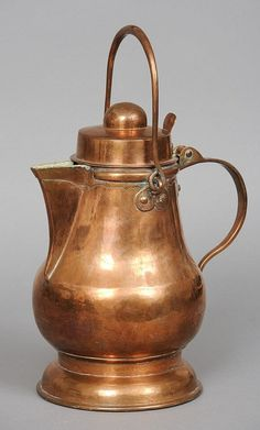 A 19th century copper water jug Of baluster form,