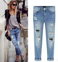 2015 más nuevas mujeres Jeans mediados de cintura vaqueros rasgados agujero  flacos del lápiz de los c3f3a406fa78