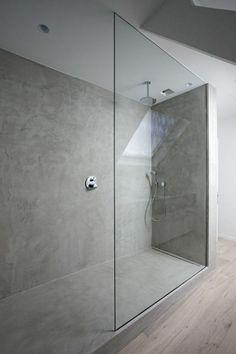 glass shower wall in modern bathroom