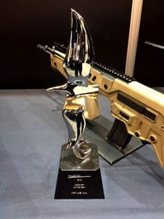 """IWI's """"Importer of the Year"""" trophy and its award winning rifle the TAVOR® SAR."""