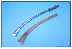This is one of the earliest Kora swords known. It is dated to the early 17 C. and originates from Central / North India. The blade is 22 inches long, extremely heavy and almost ½ inch thick at its base. The handle is somewhat different from the later Kora swords, with a cross guard of a common sword and a disk pommel. Silver cover on the handle with mesh covered cylindrical grip. Wood scabbard with its original fabric cover. Total length 29 inches.