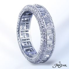 JB Star Platinum diamond eternity band handcrafted with 17 princess and 17 baguette diamonds in channel setting with pave profile.