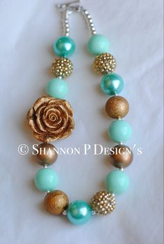 A personal favorite from my Etsy shop https://www.etsy.com/listing/268777399/gold-rose-with-turquoise-chunky-necklace