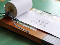 How to make a hanging notepad with repurposed receipt paper and flooring samples.